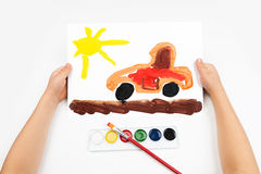 Child draws the car watercolors Royalty Free Stock Photography