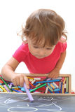 Child draws with chalk. On the blackboard Royalty Free Stock Photography