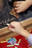 Child draws with chalk Stock Images