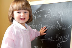 Child draws with chalk on the blackboard Stock Photography