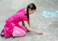 The child draws chalk. The child the girl draws chalk Royalty Free Stock Images