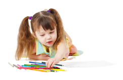 Child draws with color pencils on white. The child draws with color pencils on a white background Royalty Free Stock Photos