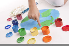 Child draws colored paints globe Stock Photography