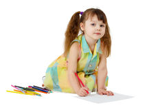 Child draws with colored pencils. On the floor Royalty Free Stock Images