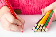 Child draws with colored pencils Royalty Free Stock Photos