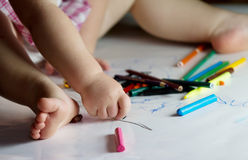 Child draws with crayons Royalty Free Stock Photography