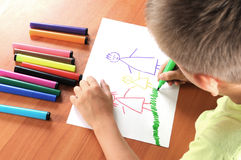 Child draws is family. On white paper by colour pensil Stock Photo
