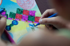 A child draws felt-tip pen. Paints a vivid picture of the view from the top Stock Photography