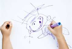 Child draws felt-tip pen on paper Stock Photos