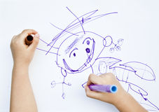 Child draws felt-tip pen on paper Royalty Free Stock Images