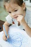 Child draws felt-tip pen on paper Stock Photo