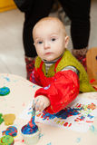 The child draws a finger paints Stock Photos