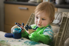 The child draws. Finger-type paints Royalty Free Stock Photos