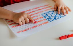 The child draws the flag of America. royalty free stock photos
