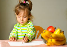 Child draws about fruit Royalty Free Stock Photos