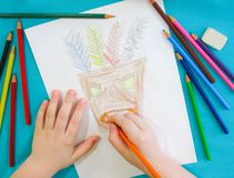A child draws a mask of an Indian. stock images