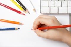 Child draws near computer Stock Photography
