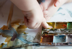 Child draws paints Royalty Free Stock Photography