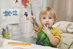 The child draws. Paints and a brush Stock Photos