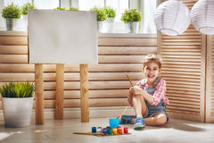 Child draws paints royalty free stock images