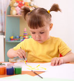 Child draws with paints in preschool Stock Image
