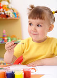 Child draws with paints in preschool Royalty Free Stock Photo