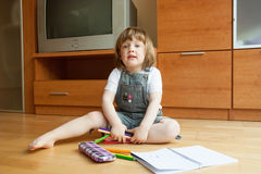 Child draws with pencils. Stock Image