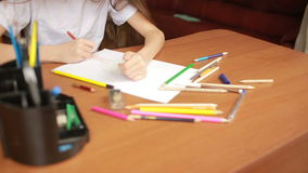 The child draws with pencils. close-up stock footage