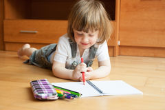 Child draws with pencils. Royalty Free Stock Photos