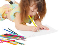 Child draws a picture with colored pencils Stock Photo