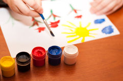 Child draws picture paints Royalty Free Stock Image