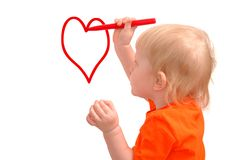 Child draws red pencil a heart Stock Photography