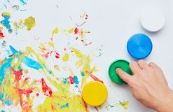 Children`s ink for drawing on a white background, finger paints, hand prints. A child draws. a child`s drawing inks, finger paints, hand prints royalty free stock images