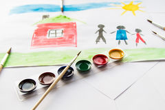 The child draws in watercolor. The child draws watercolor on paper stock photo
