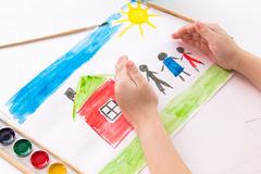 The child draws in watercolor. The child draws watercolor on paper royalty free stock photos