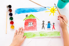 The child draws in watercolor. The child draws watercolor on paper royalty free stock images