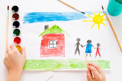 The child draws in watercolor. The child draws watercolor on paper royalty free stock photography