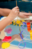 Child draws watercolor Stock Photography