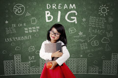Child with Dream Big text on chalkboard Stock Images
