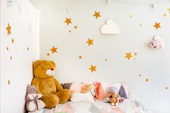 Child dream concept. Cosy bedroom decorated with toys and stars royalty free stock photo