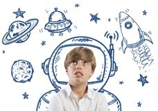 Child dreamer. Child who dreams of being in space with open eyes Stock Image