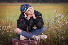 Child dreaming of travel vacation or holidays. With suitcase Royalty Free Stock Images