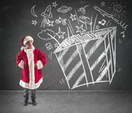 Child dreams christmas gifts Stock Photos