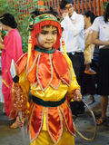 Child drees as Nezha's God. Bangkok, Thailand - October 20, 2015 : Child drees as Nezha's God (A protection deity in Chinese folk religion) with a ring and spear Royalty Free Stock Image