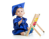 Child dressed in academic clothes with counter. Early kids education. Stock Images