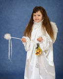 Child dressed as an angel with a magic wand Royalty Free Stock Photography