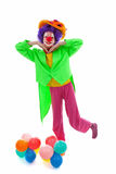 Child dressed as colorful funny clown Stock Photo