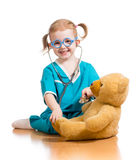 Child dressed as doctor playing with toy Stock Photo