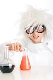 Child dressed as a mad scientist. A child with a crazy wig and wild eyes working in a laboratory Stock Photo