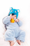 Child dressed as a mouse with cheese. Funny small child dressed as a mouse with cheese, new year Royalty Free Stock Photo